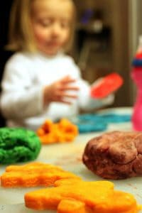 Girl playing with homemade playdough