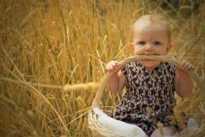 Nine month old Grace sitting in basket