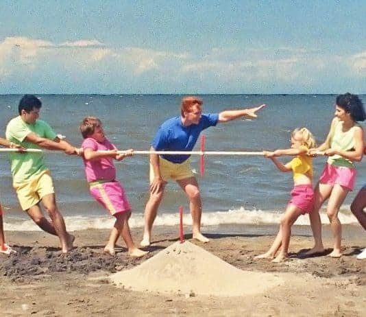 Colorful Parents Playing Tug of War on Beach