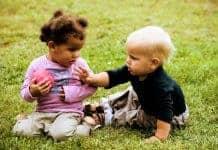 Toddler grabbing toy