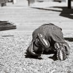 Toddler on ground having a temper tantrum B&W photo