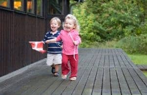 Toddlers running with the Danish Flag