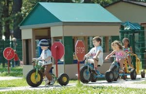 Preschoolers riding toy vehicles at a Child Development Center Supported by Army Family Covenant initiatives
