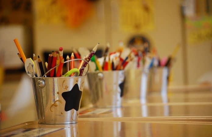 Buckets of school supplies desks