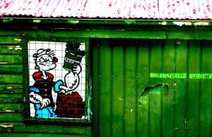 Painting of Popeye with Spinach on Old Tin Shed