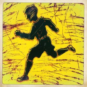 Boy running on yellow background