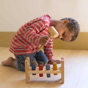 Child hammering pegs