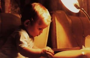 Infant looking at book