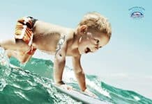 Baby Surfing in Coppertone Sunscreen Ad