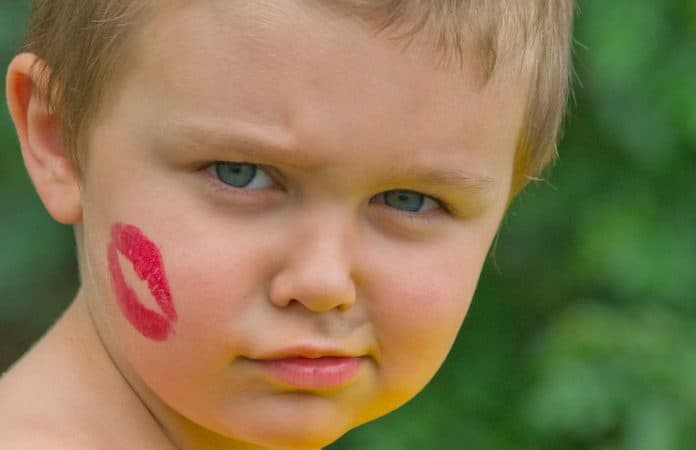 Boy with lipstick kiss