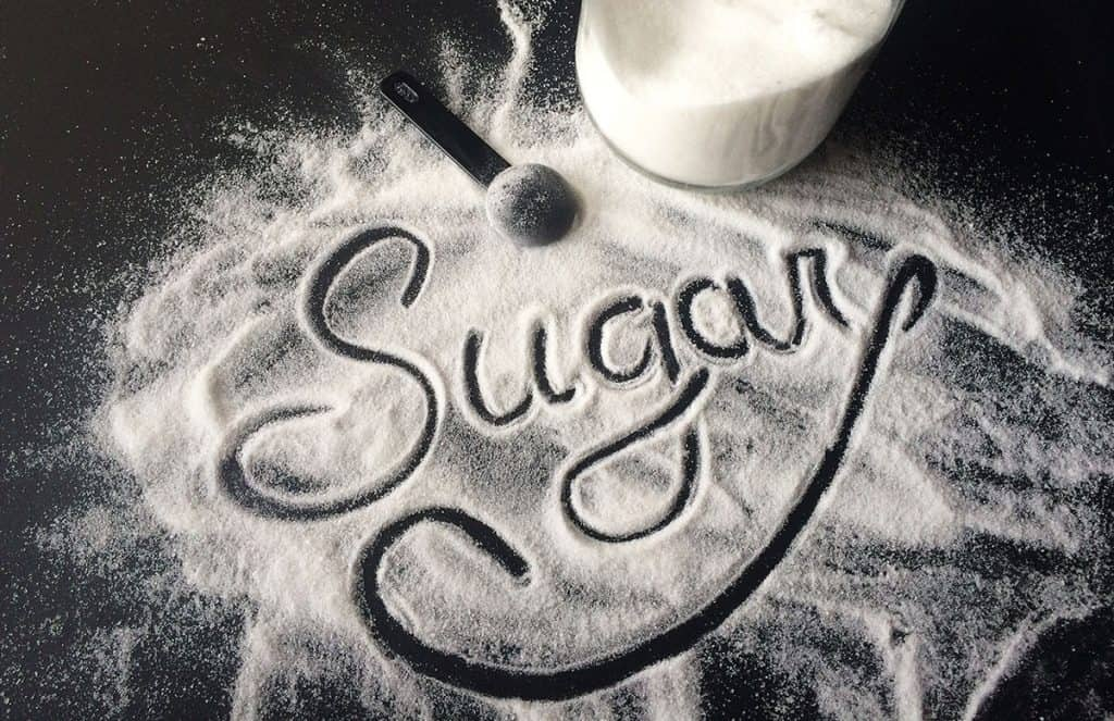 Sugar written in script. The impact of sugar on kids