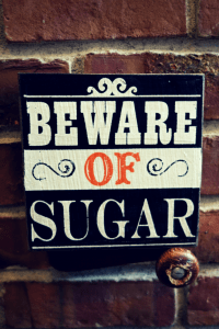 "Rustic Wooden Halloween Sign that Reads ""Beware of Sugar"""