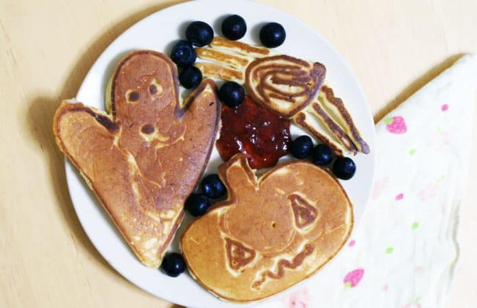 Plate of halloween shaped pumpkin pancakes