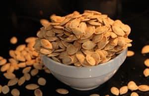 Bowl of homemade roasted pumpkin seeds
