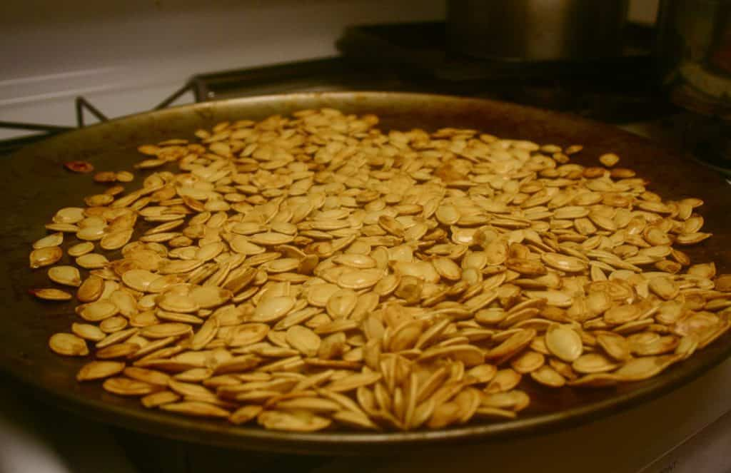 Pan of seeds pan roasting on stove