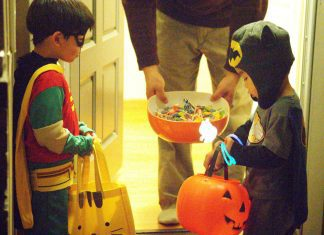 Boys wearing Costumes with Flashlights for Halloween