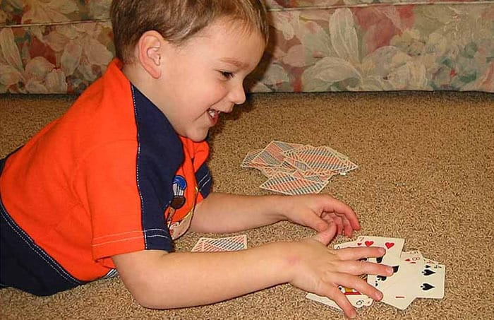 Kid playing slapjack cards