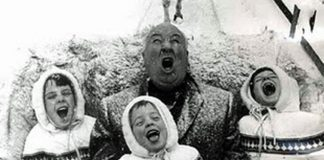 Family singing in snow on sleigh ride